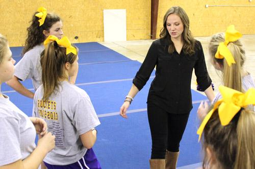 "The team's upperclassmen said they could relate to their new coach. ""She's younger, she understands what it's like to cheer,"" said Jayme Howard, senior."
