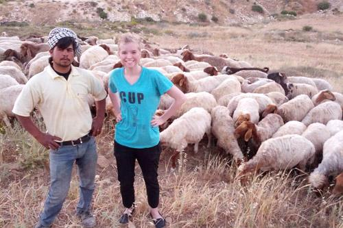Samir, a local herdsman, grazed his animals behind the hostel where Hebda stayed. Here, they pose for a picture after she and other residents doused a small brush fire that threatened his livestock.
