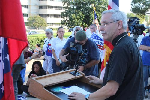 "Bishop Anthony B. Taylor delivers stinging remarks from the steps of the state capitol. ""National borders are at the service of the common good of both nations that share that border — not just the perceived self-interest of the more powerful of the two,"" he said. Dwain Hebda photo"