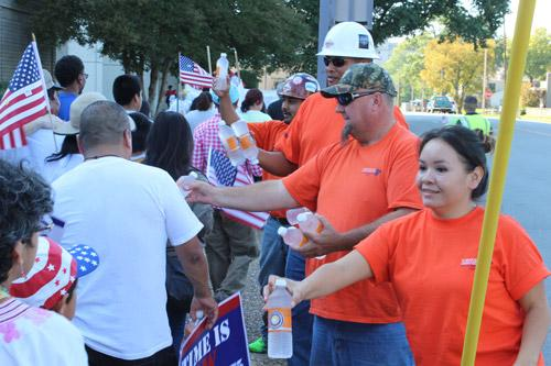 Member of the AFL-CIO set up a water station and handed out bottled water to thirsty marchers en route to the Arkansas state capitol. Dwain Hebda photo