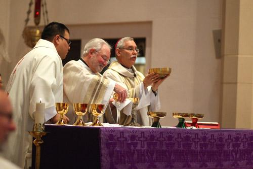 Deacon Jack Sidler Sr. assists the bishop during the Liturgy of the Eucharist.