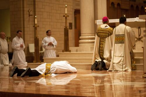 Father Jack Sidler prostrates himself during his ordination Dec. 20 at St. Benedict Church in Subiaco.(Karen Schwartz)