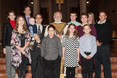 Father Jack Sidler stands with his family after his ordination at St. Benedict Church in Subiaco on Dec. 20. Father Sidler also is the only priest in the diocese who is a widower. He has three children and five grandchildren. (Karen Schwartz)