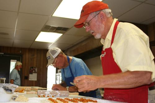Tommy Strabala and Connie Chudy (back left) prepare their apricot kolaches. (Aprille Hanson photo)