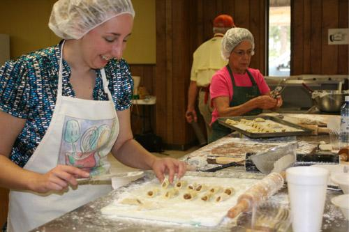 Arkansas Catholic Associate Editor Aprille Hanson is put to work making pecan-filled kolaches by the Slovak Bakers. The Slovak Bakers are open to anyone participating, no matter their level of baking experience.