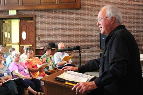 "Msgr. Richard Oswald of Little Rock, former director of the Little Rock Scripture Study, conducts morning prayer June 20. The theme for the 2015 Bible Institute was ""The Jesus of the Gospels."" (Dwain Hebda photo)"