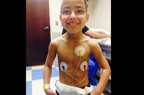 Andres Pena, who had a heart transplant as an infant, looks like any other normal, healthy 9-year-old unless he takes his shirt off. (Prints not available for this photo.)