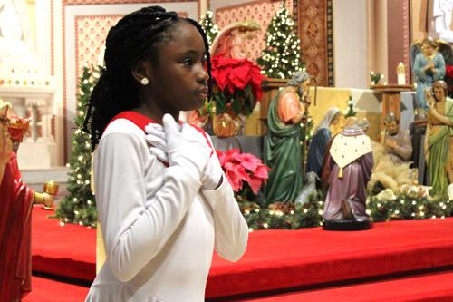 Vera Kanu, 9, a member of St. Bartholomew Church in Little Rock, performs with the liturgical dance troupe during the Martin Luther King Jr. Memorial Mass Jan. 9  (Dwain Hebda photo)