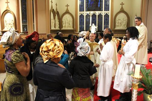 Bishop Anthony B. Taylor blesses the Igbo gift-bearers following a procession that yielded water, wine and the traditional offerings of fruit and other food.  (Dwain Hebda photo)
