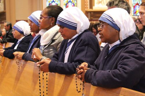 Missionaries of Charity, Calcutta (MCC) sisters pray the rosary prior to the start of the annual Mass for Life, celebrated at Cathedral of St. Andrew in Lit-tle Rock. (Dwain Hebda photo)