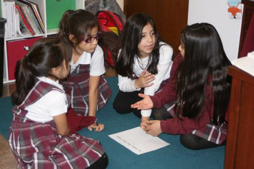 Each student group was asked to discuss a plan on how to build their tower before the gumdrops and toothpicks were passed out. Pictured are: Valeria Perez, second grade (left); Amelia Ramirez, second grade; Madison Barrera, third grade; and Karen Sekely, fourth grade. (Aprille Hanson photo)