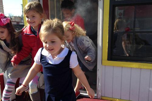 In Morrilton, Sacred Heart kindergarten students (right) learn to safely exit a smoke-filled building with the Morrilton Fire Department. On Feb. 2, students were offered a variety of mini-course activities provided in conjunction with area businesses. (Print not available for this photo.)