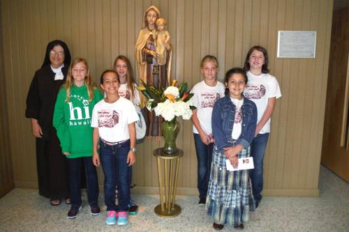 Members of the Little Flowers Girls Club baked goodies for the Carmelite Sisters in Little Rock. The girls pictured are: Rachel O'Neal, 11 (left); Madeline Stengel, 10; Hailey Stengel, 10; Brittany Stengel, 11; Maria Teresa Stengel, 9; and Emma Kuykendall, 11.