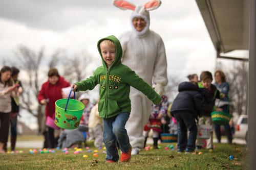 Four-year-old Anthony Piazza (at left) shares his joy during the Easter egg hunt at St. Joseph Church in Tontitown March 20. The Easter Bunny, Sharon Pianalto, also is very pleased. (Travis McAfee photo)