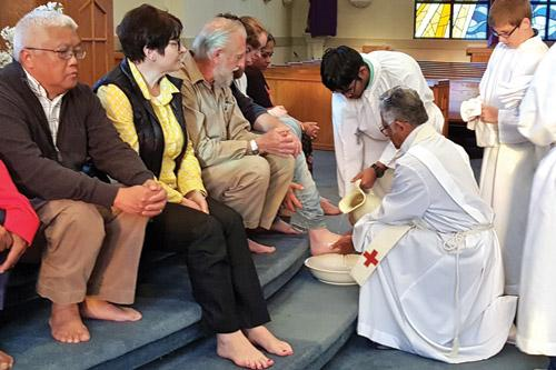 Father Felix Chirapurathel, OPraem, pastor of Immaculate Conception Church in Blytheville, washes the feet of parishioners as Jesus washed the feet of the apostles on Holy Thursday when Jesus instituted the Eucharist and the priesthood. (Prints not available)