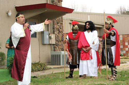Vincentian missionaries perform the Stations of the Cross on the grounds of St. James Church in Searcy. Carlos Flores portrays Pontius Pilate and Juan Chavez portrays Jesus. (Prints not available.)