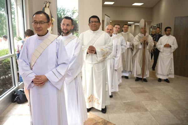 Deacons Dr. Joseph Chan, Stephen Gadberry, Mario Jacobo, Norman McFall and Taryn Whittington line up before the ordination Mass begins May 28 at Christ the King Church in Little Rock.  (Bob Ocken photo)