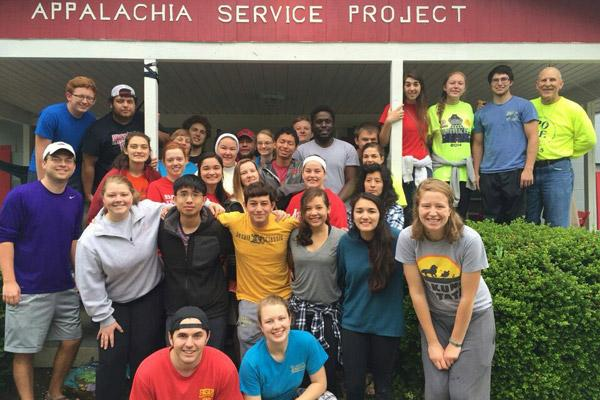 About 30 Catholic college students and chaperones traveled to Chavies, Ky., to volunteer through the Appalachia Service Project May 15-21. Pictured, back row: Casey Self (left), Cristian Robles, Grace Johnson, Sam Johnson, Sister Mary Clare Bezner, Brandon Weisenfels, Vianca Martin, Elijah Muldar, Nick Baltz, Anthony Bassey, Chance Keith, Katie Karp, Caitlyn Bartol, Blake Marshall and Deacon Richard Papini; middle row: Adam Koehler (left), Lauren Widmer, Clare Doss, Meghan McCabe, Loren Bennett, Alexa Gates, Mary Chavex and Holly Hambuchen; front row: Morgan Burke (left), Joseph Pham, Nicholas Wolpert, Jessi Balagatas and Victoria Loredo; ASP staff includes Annie, Max and Jordan.