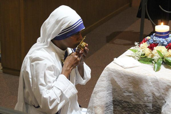 Sister Maria Jyoti kisses St. Teresa of Kolkata's relics. Then-Mother Teresa visited Little Rock in 1982 and blessed Abba House in Little Rock where the sisters still reside. (Dwain Hebda photo)