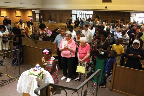 Congregants wait in line to venerate the relics of St. Teresa of Kolkata following her feast day Mass at Our Lady of Good Counsel. More than 350 congregants attended the Little Rock event. (Dwain Hebda photo)