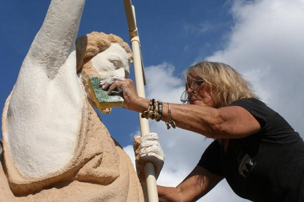 On most of the statues, including John the Baptist, Michele Bowman added two coats of primer, two coats of finishing paint and two coats of all-weather sealant to protect the statues from future damage. (Aprille Hanson photo)