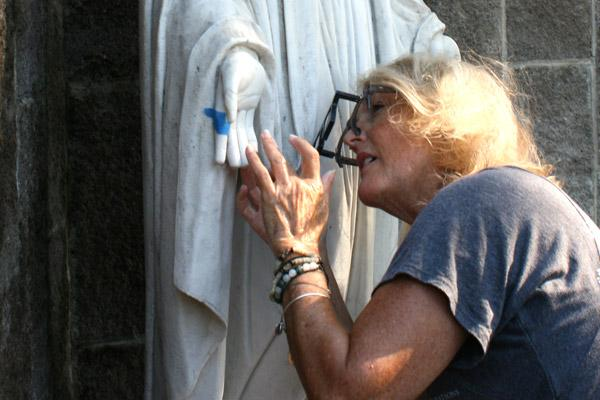 Michele Bowman molded new thumbs and a pinky finger from a manmade stone for the Virgin Mary statue and attached them with pins. She cleaned and repaired the statue for free. (Aprille Hanson photo)