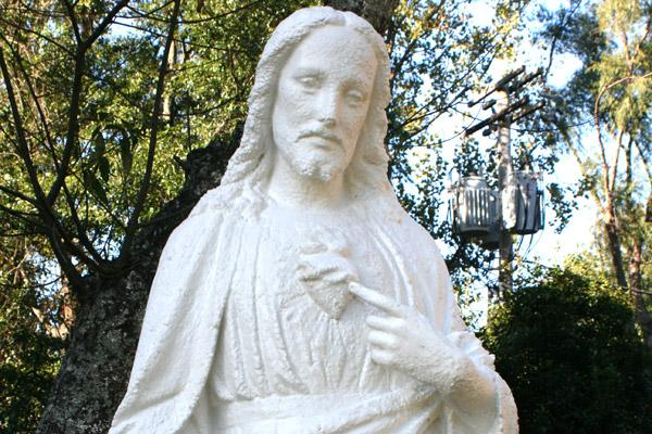 The Sacred Heart of Jesus statue was primed, painted and sealed after Michele Bowman saw it and agreed to repair it at no additional charge after she arrived on campus. (Aprille Hanson photo)