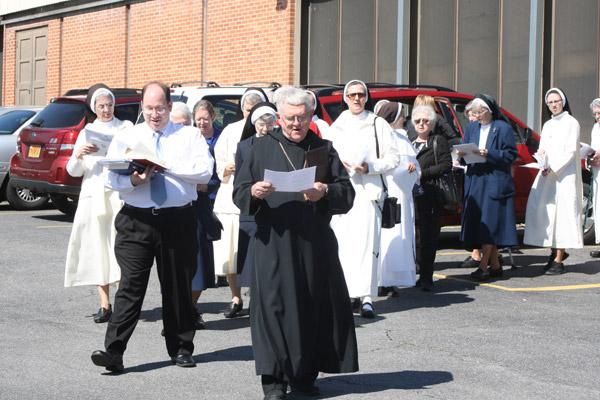 Abbot Leonard Wangler, OSB, of Subiaco Abbey leads 50 religious women and men March 5 from the church gymnasium to the Door of Mercy at Our Lady of Good Counsel Church in Little Rock. (Malea Hargett / Arkansas Catholic file)
