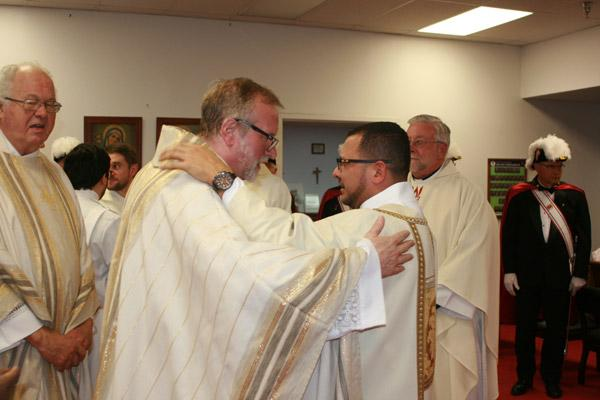 "Msgr. Scott Friend, diocesan director of vocations, hugs Deacon Rubio, who he called ""inspiring."" (Aprille Hanson photo)"
