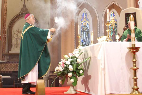 Bishop Anthony B. Taylor incenses the altar at the Cathedral of St. Andrew at the start of the Mass for Life. (Malea Hargett photo)