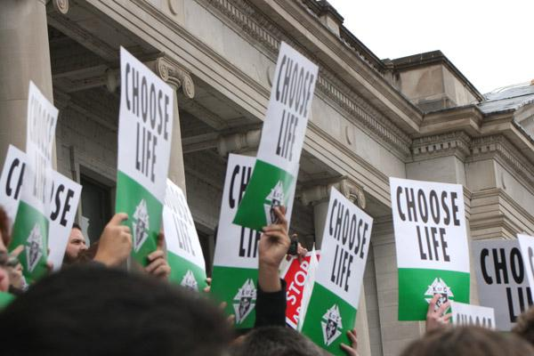 March for Life participants hold up Choose Life signs provided by the Knights of Columbus. (Malea Hargett photo)