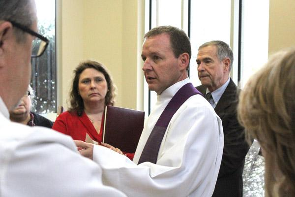 Father Erik Pohlmeier gives last minute instructions to the assembled Directors of Religious Education before the Rite of Election at Christ the King Church in Little Rock March 5. (Dwain Hebda photo)