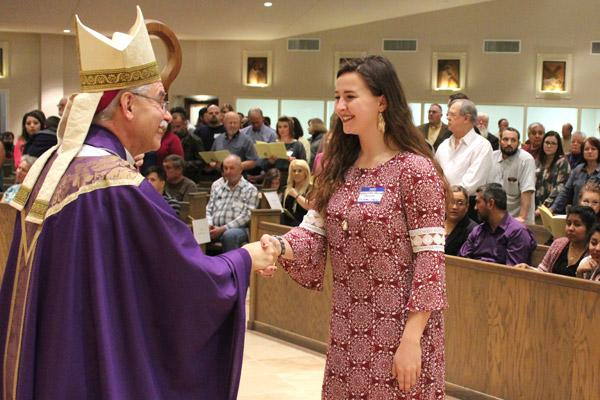 Vanessa Shields beams as she is greeted by Bishop Taylor March 5. Shields is a candidate from St. James Church in Searcy. (Dwain Hebda photo)