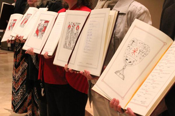 Names of candidates and catechumens are displayed in the Book of the Elect. More than 44 parishes across the diocese are ushering in new members to the Church.  (Dwain Hebda photo)