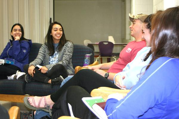 Students at the University of Central Arkansas in Conway laugh and share stories during a Bible study in Baridon Hall dormitory March 2. Junior Jocelyn Leyva (second from left), 20, said it's her first time leading a Bible study group. (Aprille Hanson photo)