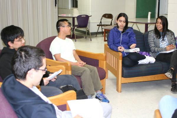 Freshman Michael Nguyen, 18, (white shirt) talks about Lent during a UCA Bible study. Also pictured are Jordan Rivera (left), Joseph Pham, Elena Lainez and Jocelyn Leyva, the Bible study leader. (Aprille Hanson photo)