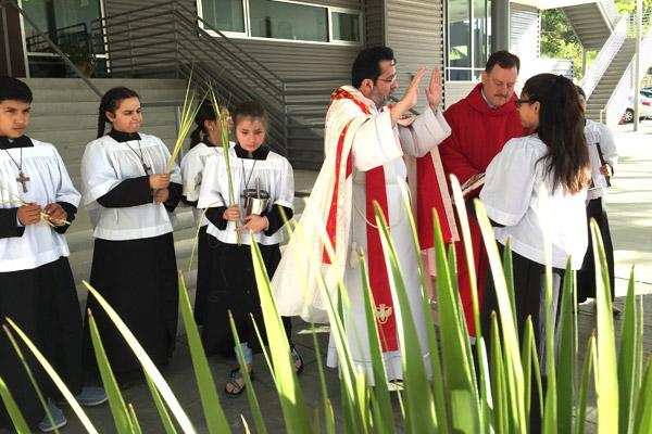 Father Ariel Ramirez, CM, with pastor Father George Sanders, blesses the palms to be used during the Spanish Mass on Palm Sunday, April 9 at St. Mary Church in Hot Springs. The parish recently expanded its ministry to Hispanics. (Judy Peters photo) Prints not available for this photo.