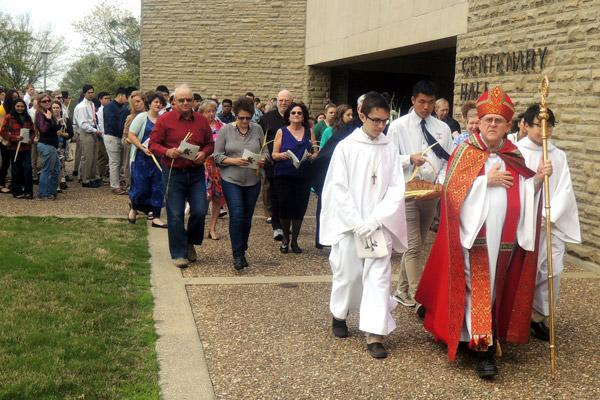 Abbot Leonard Wangler leads monks, parishioners and students in a Palm Sunday procession from Centenary Hall to Abbey Church at Subiaco. (Courtesy Subiaco Abbey) Prints not available for this photo.