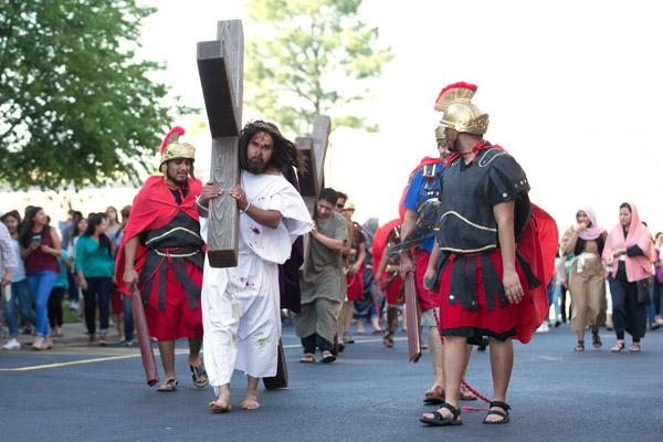 Alfredo Rodriguez carries the cross as Jesus during the Live Stations of the Cross at Immaculate Conception Church in Fort Smith on Good Friday, April 14, while guards Juan Raya (left), Juan García and Juan Orozco surround him. (Karen Schwartz photo)