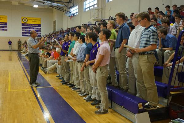 The Schola Choral Group sings after Principal Steve Straessle welcomed everyone to Aubrey Volpert's signing day May 9 at Catholic High School for Boys in Little Rock. (Aprille Hanson photo)
