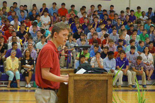 Aubrey Volpert speaks to fellow Catholic High classmates May 9 about his decision to join the seminary and become a priest. (Aprille Hanson photo)