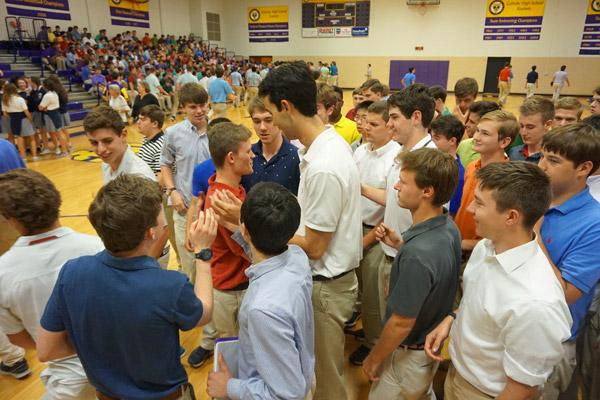 Catholic High seniors congratulate Aubrey Volpert after the signing day ceremony. (Aprille Hanson photo)