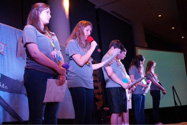 Johanna Berryman, of St. Joseph in Fayetteville, leads a prayer for the 350 teenagers at the Catholic Youth Convention, held at the DoubleTree Hotel in Little Rock. Others pictured are: Ardyn Townzen (left), St. Stephen, Bentonville; Jesus Avila, St. John, Hot Springs; Connor Kordsmeier, Our Lady of Fatima, Benton; Jojo Vazquez, St. John, Hot Springs; and Avanlea Furr, St. Agnes, Mena. (Aprille Hanson)