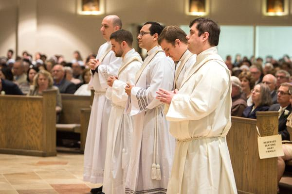 Fathers William Burmester, Stephen Hart, Ramsés Mendieta, Martin Siebold and Luke Womack stand during their priestly ordination May 27 at Christ the King Church in Little Rock. Including these five men, 26 have been ordained to the priesthood by Bishop Anthony B. Taylor from 2009 to 2017. (Travis McAfee photo)