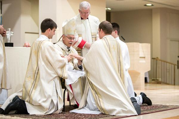 Bishop Anthony B. Taylor anoints the hands of Father Martin Siebold during his ordination. (Travis McAfee photo)