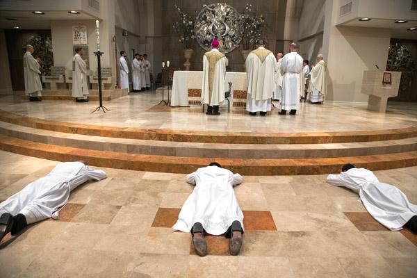 During the Litany of Supplication the elect lay prostrate before the altar, in an act of surrender to God. (Bob Ocken photo)
