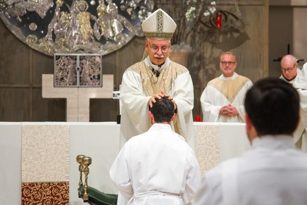 Bishop Anthony B. Taylor lays his hands on Deacon Joseph de Orbegozo, receiving the strength of the Holy Spirit. (Bob Ocken photo)
