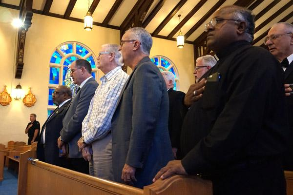 "Faith leaders throughout the Hot Springs community gathered to pray for first responders Sept. 11, including Father Chinnaiah Irudayaraj ""Y.C."" Yeddanapalli, pastor at St. John Church (right). (Aprille Hanson photo)"