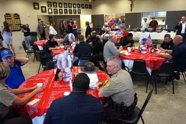 First responders were treated to a free breakfast from 6 a.m. to 9 a.m. Sept. 11 at St. Mary's parish hall. About 300 people attended with more than 100 stopping by for carry-out meals. (Aprille Hanson photo)