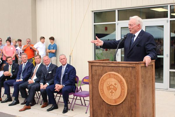 Jerry Jones spoke during the dedication ceremonies as dignitaries look on. They include Jim Williams (left) of Little Rock, Shy Anderson, CHS Principal Steve Straessle, Jerry Jones Jr. and Stephen Jones. (Dwain Hebda photo)
